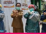 CPM Bantu Puskesmas Kawatuna Bilik Disinfektan