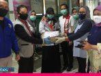 KNPI Sulteng Bantu APD ke Tim Medis di Palu