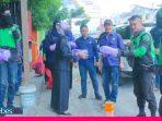 NasDem Palu Bagikan 200 Paket Makanan Bagi Pekerja Ojol