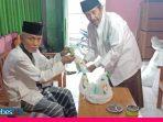 Imam Masjid dan Pegawai Syara di Sigi dapat Bantuan Disinfektan dan Masker dari BAZNAS