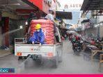Pertokoan Hasanudin Palu Disemprot Disinfektan, Ratusan Pengunjung Berhamburan