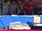Polisi Sita Ribuan Butir Pil Ekstasi dan Uang Rp 855 Juta dari Tangan Seorang Bandar di Palu