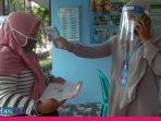 SDN 15 Palu Terapkan Protokol Kesehatan dalam Pendaftaran Calon Siswa Baru