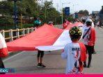 Peringati HUT RI ke-75, Tim Jelajah Sepeda Lipat Palu-Poso Bentangkan Bendera Merah Putih Sepanjang 75 Meter